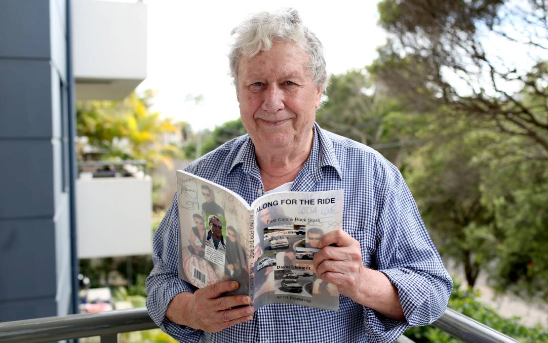 STAR STRUCK: Author David Clement with this book 'Along for the Ride: Fast cars and rock stars' that he penned about his friendship with INXS. Picture: Geoff Jones